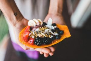 smoothie bowl inside papaya with berries - Homebiotic - ways to detox mold illness